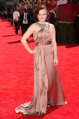 Elisabeth Moss, in Reem Acra and Chopard jewels.