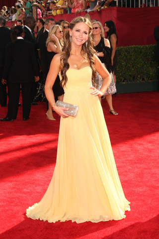 Jennifer Love Hewitt, in Max Azria with a Leiber purse.