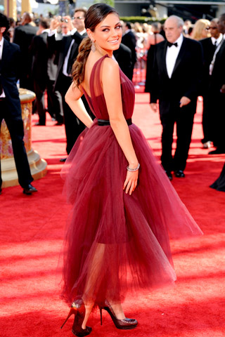 Mila Kunis, in Monique Lhuillier, Ferragamo shoes, and Fred Leighton jewels.